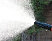 15165030-water-spraying-from-a-garden-hose